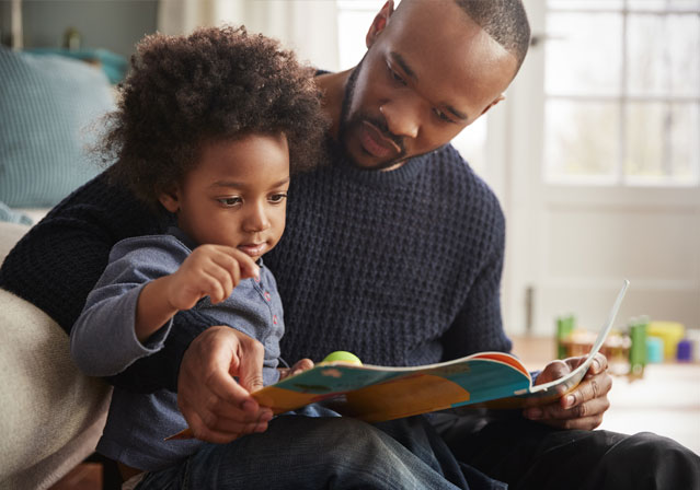 Man teaching a child to read